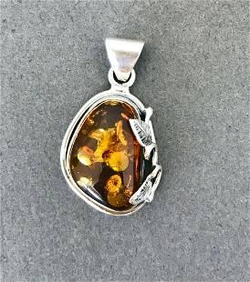 Beautiful Amber Pendant shaped like an Ornament
