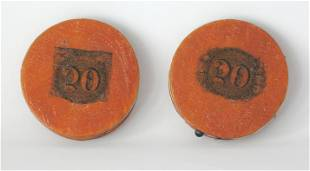 Two early round needle cases.