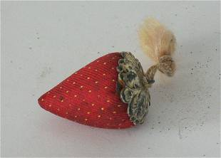 Early strawberry emery with metal top.