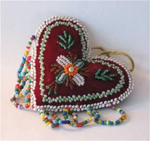 Vintage beaded Indian heart shaped pincushion.