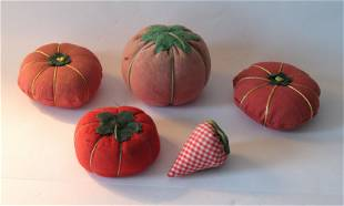 Group of five vintage tomato pincushions.