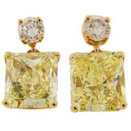 Fancy Yellow GIA and White Diamond Gold Two-Stone Stud