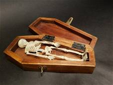 Miniature RIP Coffin w Skeleton