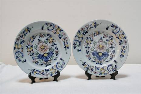 A fine pair of mid 18th century English delft plates