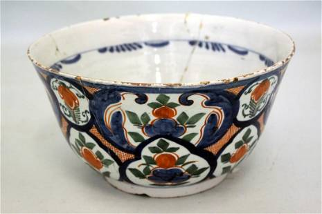 An early 18th century steep sided Dutch delft punch
