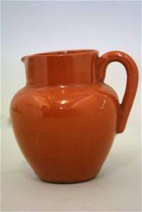 A mini redware pitcher