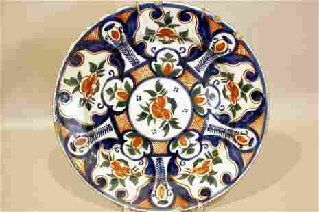 A good early 18th century Dutch delft charger decorated