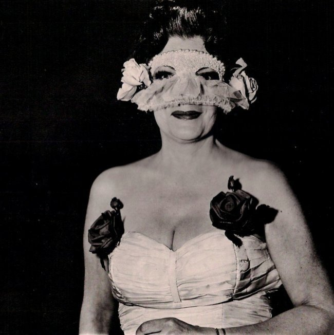 Diane Arbus: Lady at Masked Ball with Rose, NY 1967