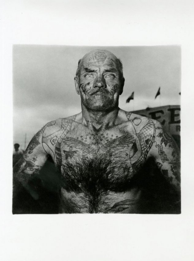 Diane Arbus: A Tattooed Man at Carnival, MD