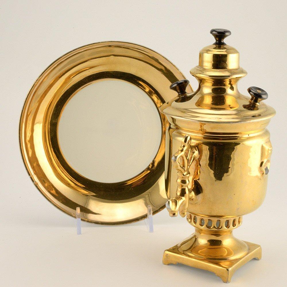 A Kuznetsov Samovar-Form Covered Cup and Saucer