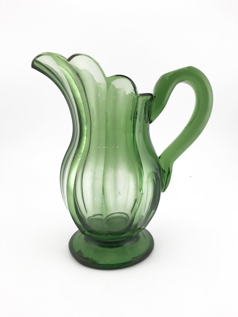 Green handblown cut glass pitcher, late 19th century