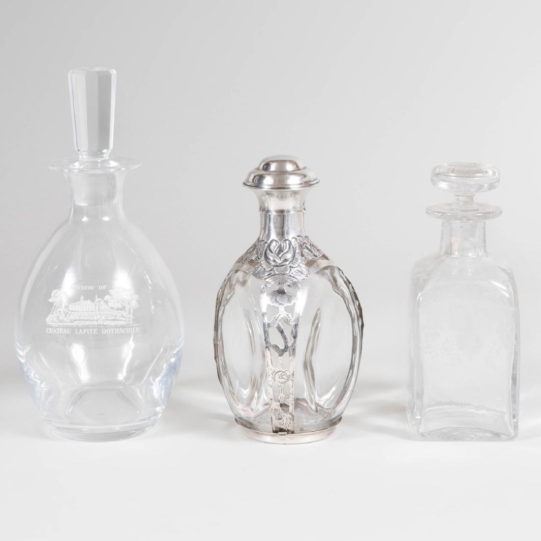 Two Glass Decanters and Stoppers, and a Mexican