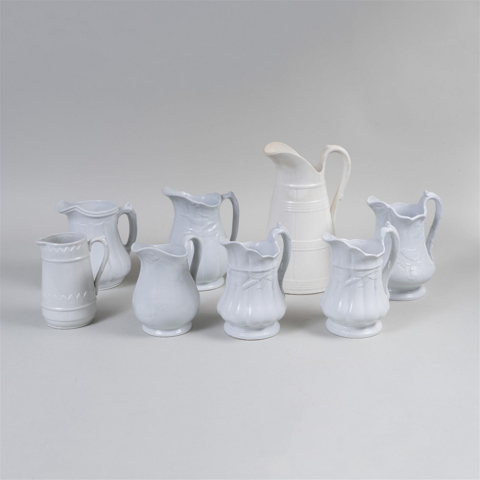 Group of Six English Ironstone Jugs and Two White