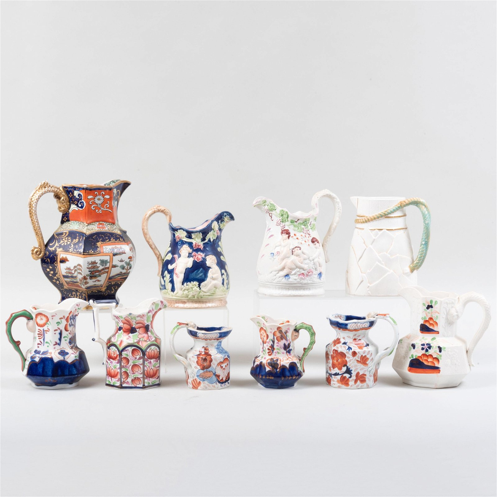 Group of Seven English Ironstone Pitchers and Three