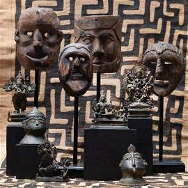 Group of Four Ethnographic Carved Wood Masks, Possibly