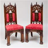 Pair of English Neo-Gothic Carved Oak Hall Chairs,
