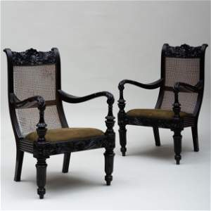 Pair of Anglo-Indian Carved Ebony and Caned Armchairs,