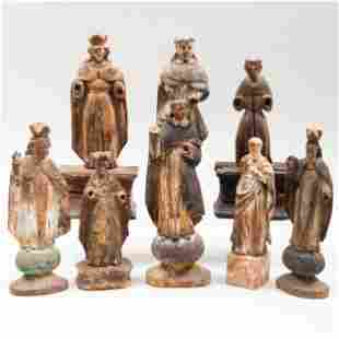 Group of Eight Carved and Polychromed Devotional