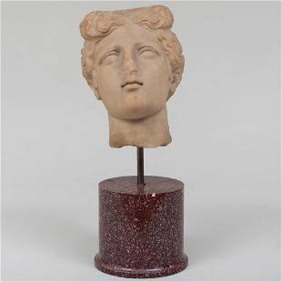Carved Marble Bust of a Woman on a Porphyry Socle,