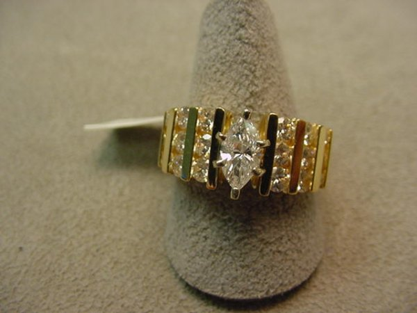 5007: 14K GOLD .40 CT MARQUISE DIAMOND RING