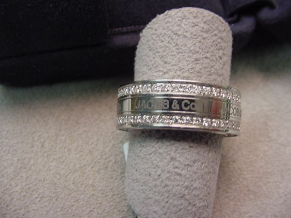 5018: JACOB & CO METAL RING WITH SEVERAL SMALL DIAMONDS