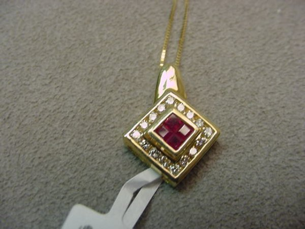 5023: 14K GOLD RUBY AND DIAMOND PENDANT ON 14K CHAIN