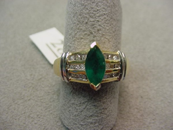 5028: 14K GOLD EMERALD AND DIAMOND RING