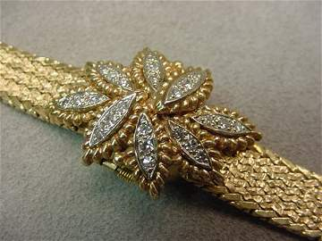 5076: LADIES 17J  14K GOLD DIAMOND BRACELET WATCH