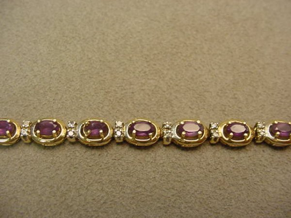 6008: 14K GOLD AMETHYST AND DIAMOND BRACELET