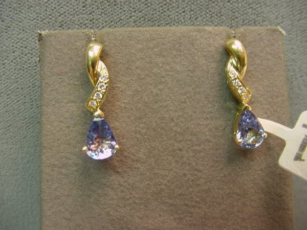 6011: PAIR 14K GOLD TANZANITE AND DIAMOND EARRINGS