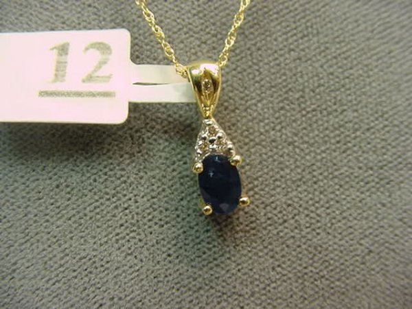 6012: 10K GOLD BLUE SAPPHIRE AND DIAMOND PENDANT