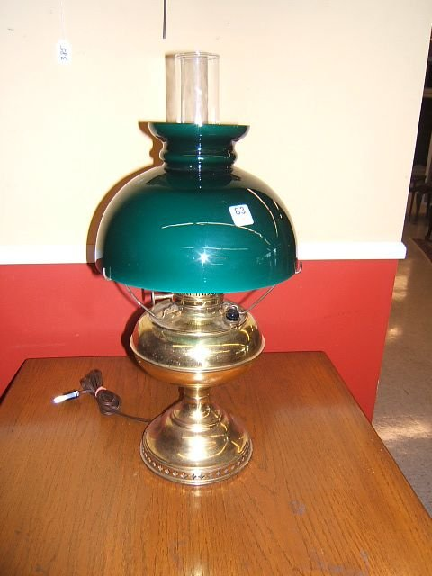7083: BRASS LAMP WITH CASED GLASS SHADE