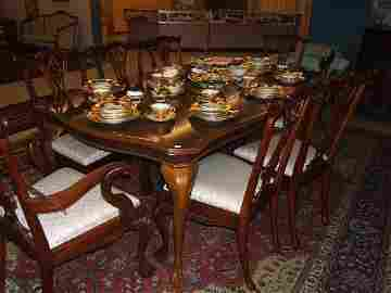 7379: DINING ROOM TABLE WITH  8 CARVED CLAWFOOT CHAIRS