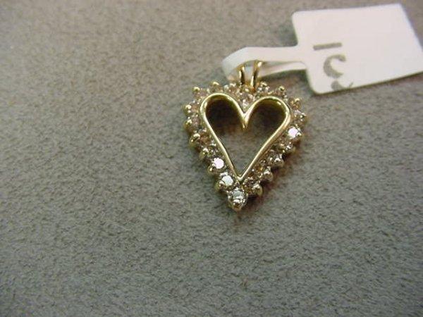 1003: 10K GOLD DIAMOND HEART PENDANT