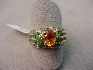 1085: 14K GOLD GARNET AND DIAMOND RING