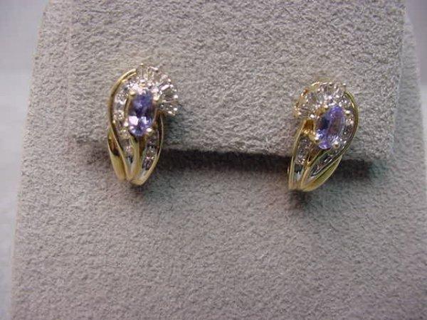 4013: PAIR 14K GOLD TANZANITE AND DIAMOND EARRINGS