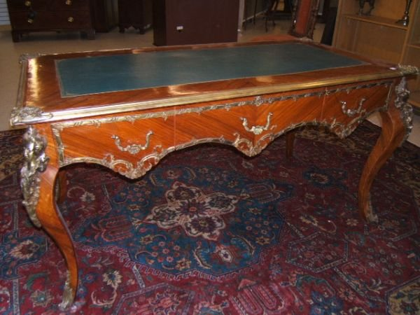 5051: BRONZE MOUNTED LEATHER TOP WRITING TABLE
