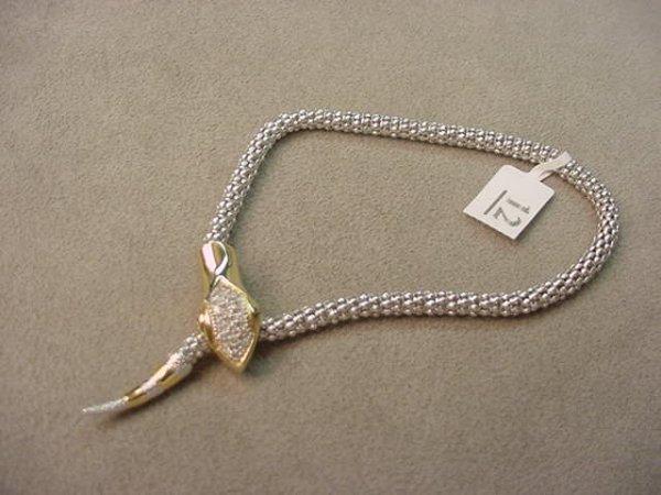 6012: 14K GOLD LARIAT RUBY AND DIAMOND SNAKE BRACELET