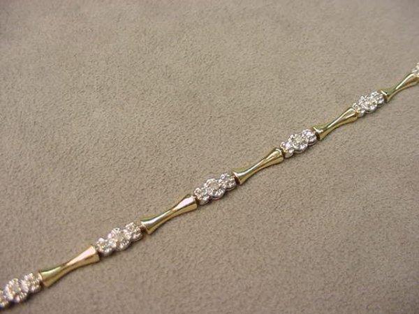 6014: 10K GOLD DIAMOND BRACELET