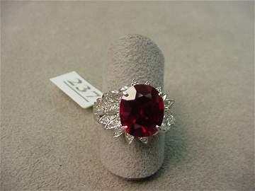 6237: 14K WHITE GOLD GARNET AND DIAMOND RING