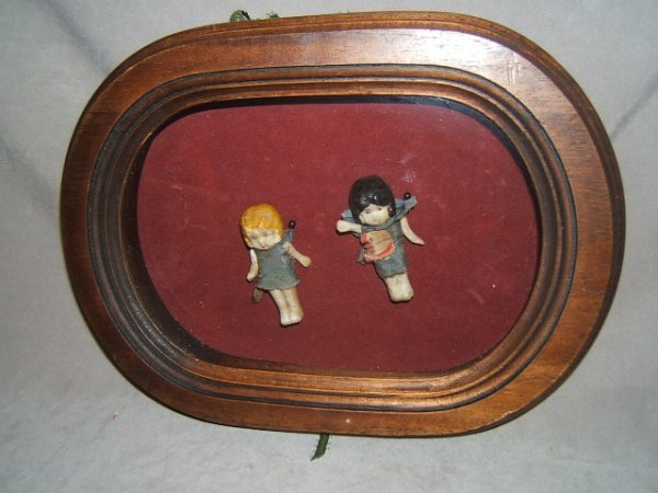 7017: 2 ANTIQUE BISQUE JOINTED DOLLS IN FRAME