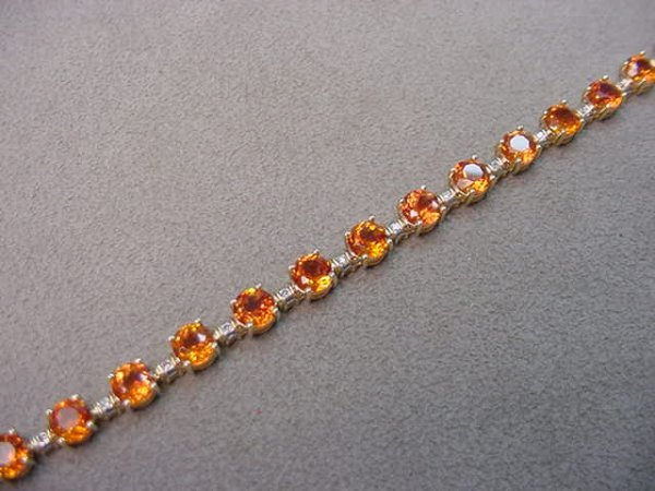 8011: 10K GOLD DIAMOND AND ORANGE SAPPHIRE BRACELET