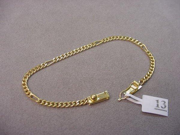 8013: 1 7 1/2 INCH TESTED 18K GOLD BRACELET