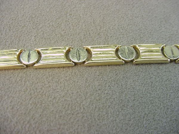 1016: 14K YELLOW AND WHITE GOLD BRACELET