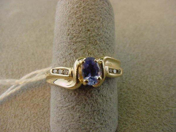 2073: 14K GOLD TANZANITE AND DIAMOND RING
