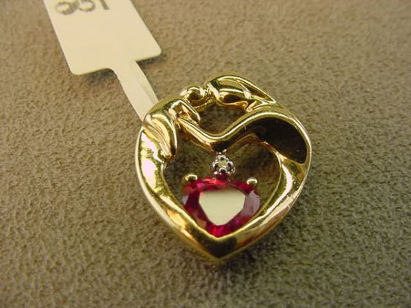 3008: 10K GOLD RED STONE AND DIAMOND HEART PENDANT