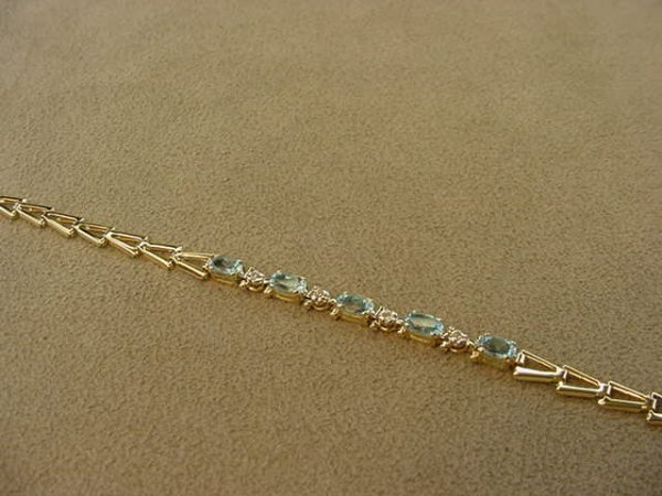 3020: 10K GOLD BLUE TOPAZ AND DIAMOND BRACELET