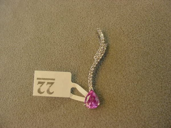 3022: 18K WHITE GOLD PINK SAPPHIRE AND DIAMOND PENDANT