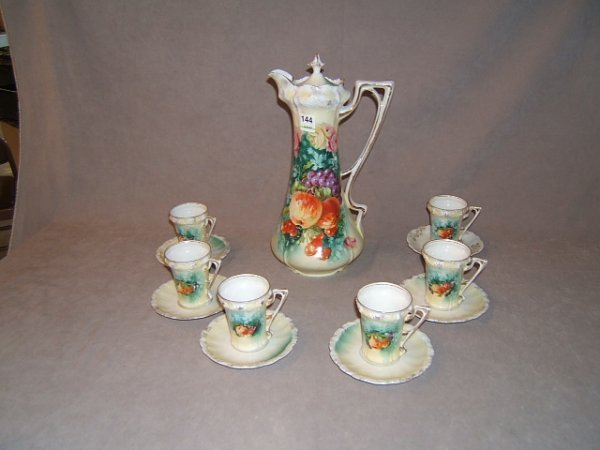 4144: R.S. PRUSSIA CHOCOLATE POT AND 6 CUPS AND SAUCERS
