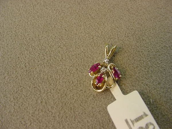 5018: 14K GOLD RUBY AND DIAMOND PENDANT